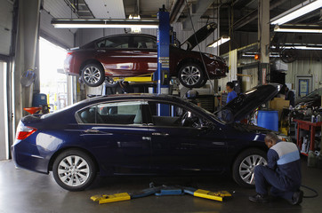 Honda auto technician Okine performs preparation and inspection on first 2013 Honda Accord's to arrive at Sport Honda in Silver Spring, Maryland