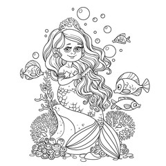 Beautiful little mermaid girl sits on a rock and combs her hair