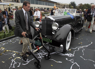 Cassini walks around his car after winning the Best of Show award for his 1934 Packard at the Concours d'Elegance in Pebble Beach