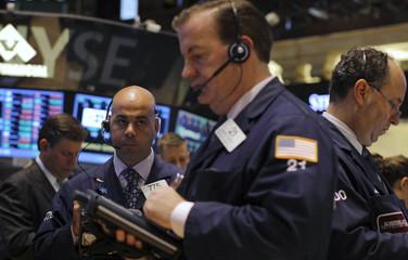 Traders work on floor of New York Stock Exchange
