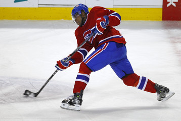 Montreal Canadiens defenseman Subban takes a shot on the Buffalo Sabres during the first period of NHL hockey action in Montreal