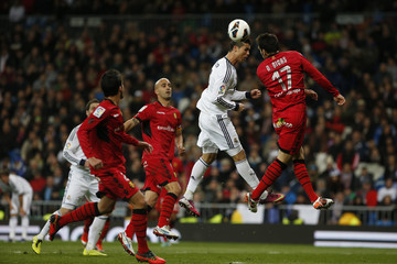 Real Madrid's Cristiano Ronaldo heads the ball past Real Mallorca's Pedro Bigas during their Spanish first division soccer match at Santiago Bernabeu stadium in Madrid