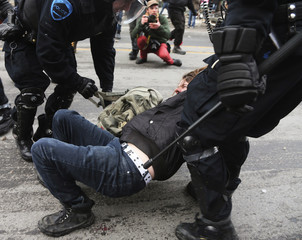 A protester is arrested during a demonstration following the Summit of Higher Education in Montreal