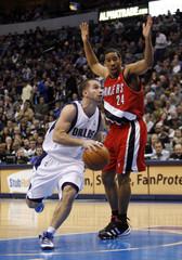 Mavericks guard Barea drives on Trail Blazers guard Miller during their NBA basketball game in Dallas, Texas
