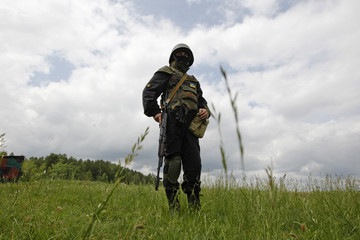 "A member of the ""Donbass"" self-defence battalion takes part in a training at a base of the National Guard of Ukraine near Kiev"