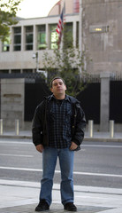 Brother of Spanish cameraman Couso who died during 2003 invasion of Iraq poses in front of the U.S. embassy in Madrid