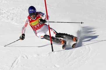 Jean-Baptiste Grange of France clears a gate during the first leg of the men's World Cup slalom skiing race in Val d'Isere