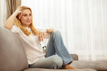 Beautiful mature woman relaxing at home