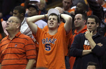 Syracuse fans react after loss to Marquette University during their third round NCAA basketball game in Cleveland