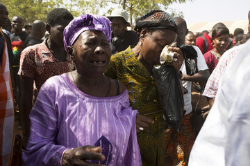 Mourners cry during  funeral service for six people killed during popular uprising of October 30 and 31 in Ouagadougou