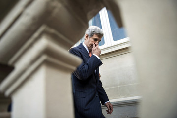 US Secretary of State John Kerry leaves after a family photo at the International Conference on Peace and Security in Iraq, at the Quai d'Orsay in Paris
