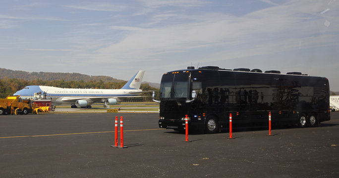 Air Force One is pictured in background as bus carrying U.S. President Obama leaves Asheville Airport for a three-day bus tour of North Carolina and Virginia