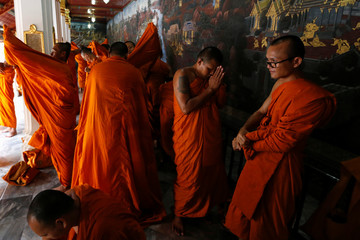 Buddhist monks get ready for a ceremony at the Grand Palace to commemorate Thailand's King Bhumibol Adulyadej's 70th anniversary on the throne