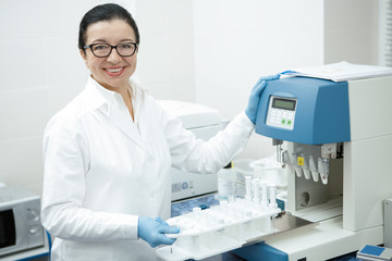 Senior female researcher working on laboratory equipment