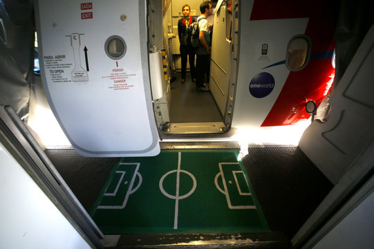 A floor cover designed like a soccer pitch is seen at Alfonso Pena International Airport in Curitiba