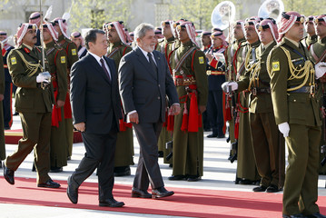 Jordan's King Abdullah and Brazil's President Luiz Inacio Lula da Silva inspect a Bedouin guard of honour unit upon his arrival at the Royal Palace in Amman