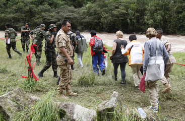 Peruvian soldiers help tourists evacuate the town near the Inca ruins of Machu Picchu by helicopter, in Cuzco