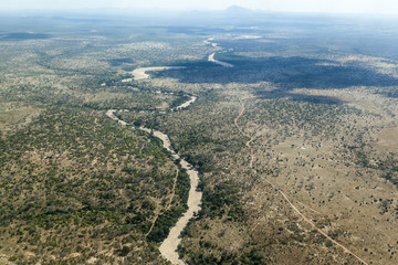 Aerial view somewhere above the Serengeti National Park and the Great Rift Valley - Tanzania Africa