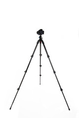 Photo camera on tripod isolated over white background