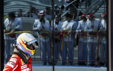 Ferrari Formula One driver Alonso of Spain walks after the Turkish F1 Grand Prix at the Istanbul Park circuit in Istanbul