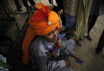 Mahesh, 14, gets ready for his marriage in a village near Kota