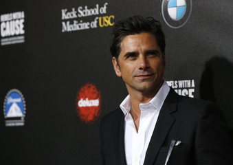 """John Stamos poses at second annual """"Rebels With a Cause"""" gala at Paramount Pictures Studios in Los Angeles"""
