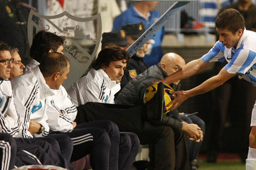Real Madrid's coach Mourinho gives the ball with his feet to Malaga's Portillo during their Spanish First Division soccer match  in Malaga