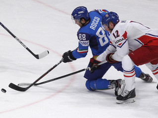 Italy's Rocco fights for the puck with Czech Republic's Novotny during their 2012 IIHF men's ice hockey World Championship game in Stockholm