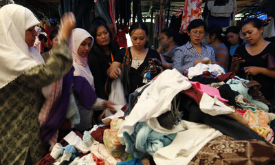 Women shop for new clothesat a temporary market in Jakarta