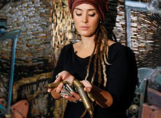 Ukrainian artist Marchenko shows bullet cases in Kiev