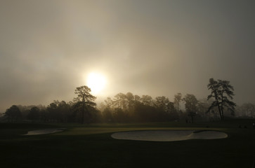 The sun comes up over the second hole during a practice round for the 2012 Masters Golf Tournament at the Augusta National Golf Club in Augusta