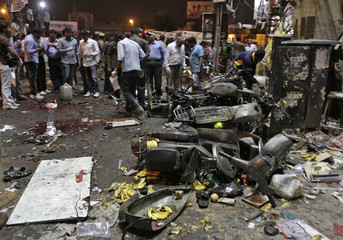 Police examine the site of an explosion at Dilsukh Nagar, in the southern Indian city of Hyderabad