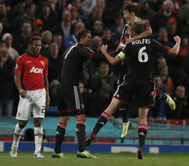 Bayer Leverkusen's Rolfes celebrates scoring with teammates Son and Boenisch during their Champions League soccer match against Manchester United at Old Trafford in Manchester