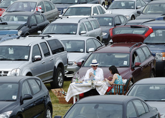 Racegoers picnic in the car park on the fourth day of racing at Royal Ascot in southern England