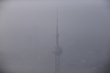 Shanghai's landmark building Oriental Pearl TV Tower as seen from the Shanghai World Financial Center amid heavy smog in Shanghai