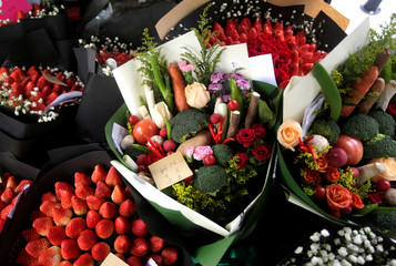 Bouquets made of vegetables, strawberries and flowers are seen in a vehicle as a delivery staff of a florist prepares to deliver them for clients on Valentine's Day in Beijing
