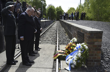 Israeli President Rivlin pays his respect in front of the tracks of the 'Gleis 17' (Platform 17) memorial at Grunewald railway station in Berlin