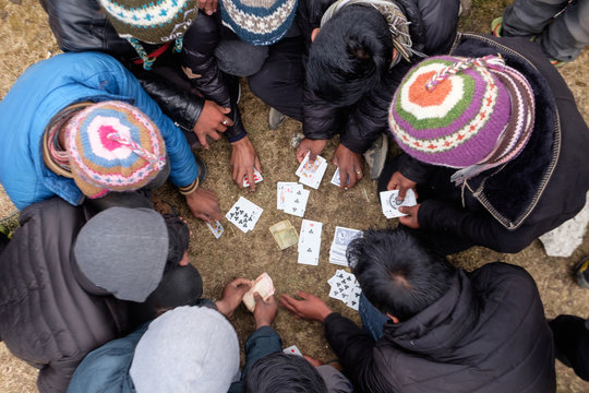 Sherpas are enjoying moments of card game in late afternoon in Himalaya, Nepal