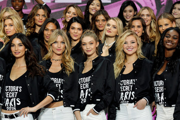 Models pose for a group photograph during a photocall before the Victoria's Secret Fashion Show at the Grand Palais in Paris