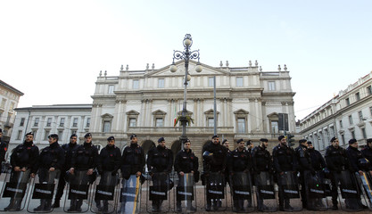 Carabinieri police keep guard in front of La Scala opera house on the first day of opera season in downtown Milan