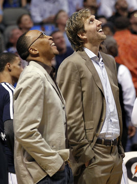 Dallas Mavericks Shawn Marion and forward Dirk Nowitzki look at the scoreboard during their NBA basketball game against the Toronto Raptors in Dallas