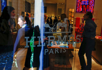 People are seen inside the new Hermes boutique in Rome