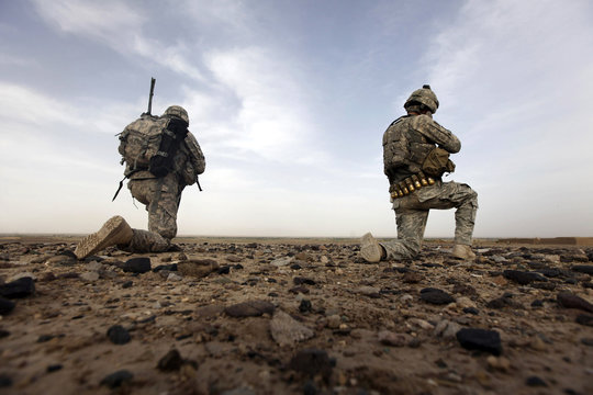Soldiers from the U.S. Army's 2nd Platoon, A Co, 4-23 Inf Battalion, 5th Stryker Brigade Combat Team scan the landscape for Taliban fighters near the Helmand/Kandahar border