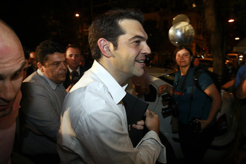 Head of Greece's Left Coalition party Tsipras arrives at his party headquarters in Athens