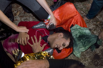 A migrant suffering from hypothermia reacts as refugees and migrants arrive on an overcrowded dinghy on the Greek island of Lesbos, after crossing a part of the Aegean Sea from the Turkish coast