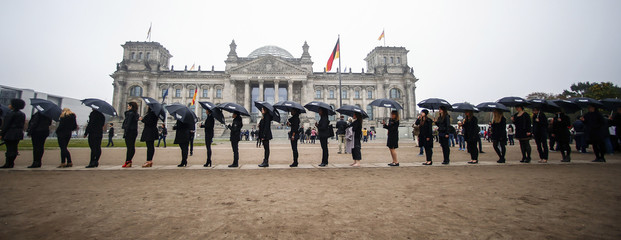"Activists demonstrate during a ""Walk for Freedom"" to protest against human trafficking in Berlin"
