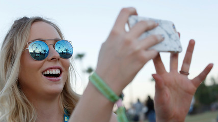 Josie Frost takes a photo of her mom during the Desert Trip music festival at Empire Polo Club in Indio