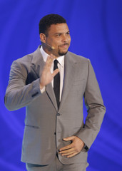 Ronaldo waves his hand during the draw for the 2014 World Cup in Sao Joao da Mata