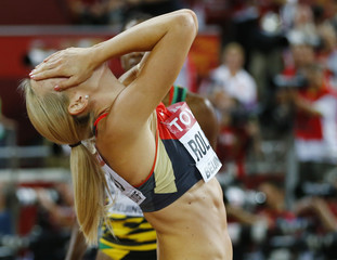 Second placed Roleder of Germany reacts after winning silver at the women's 100 metres hurdles final during the 15th IAAF World Championships at the National Stadium in Beijing