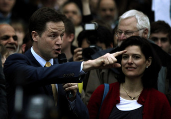 Britain's Liberal Democrat party leader Clegg stands with his wife Durantez as he addresses a general election campaign rally in Sheffield